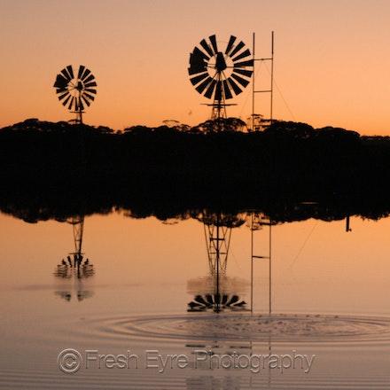 07BR07_016_Kerri Cliff - Windmills on Barna Dam at sunset