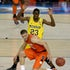 Michigan-Syracuse - Brandon Triche (20) of the Syracuse Orange loses control of the ball in front of Caris LeVert (23) of the Michigan Wolverines in the...