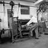 Tanning Worker - Each archival photograph is stamped and signed by Robert and a brief description of how it was taken.
