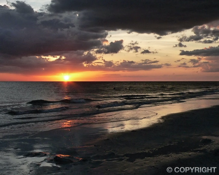 Indian Rocks Sunset - A breathtaking seascape of Divine art captured on Indian Rocks Beach, Florida.