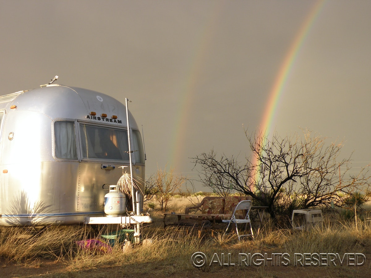 Rainbow over Airstream - 1972 Airstream with a rainbow.