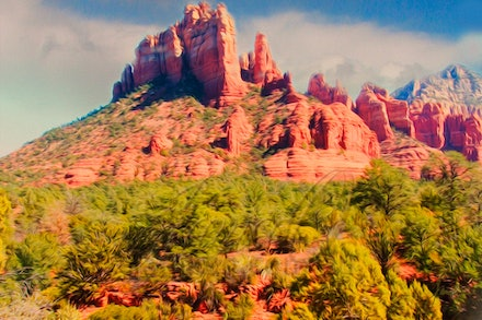 The Sentinel - Soaring red sandstone monoliths line the valleys surrounding the small town of Sedona in Arizona. Feelings of mystic connections to the...