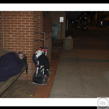 Lady sleeping at bank - Wheeling WV
